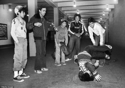 Breaking: Martha Cooper captures the High Times Crew break-dancing outside Washington Heights police station in 1980.