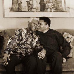Muhammad  Ali kissing Nelson Mandela