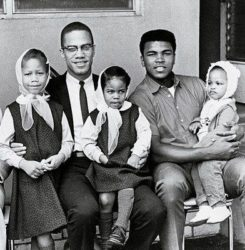 Malcolm X and his daughters (left to right girls maybe Malcolm's 1st 3 of 6; Attallah, Qubilah and Ilyasah) with Ali.