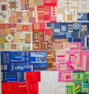 """Ive Felix's """"Changing Neighborhood"""" - Machine piece and quilted using reproduction fabric designs from 1892 and modern fabrics. 72""""x69"""". Photos by Burroughs Lamar"""