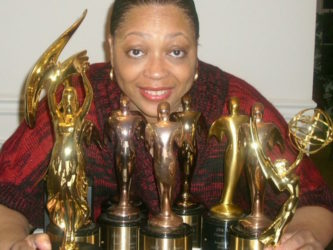 "Beverly Lindsay-Johnson with her various awards for ""Dance Party: The Teenarama Story"""