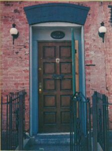 Classic doorwith knocker: wroughtiron entrance to antiquesetting.