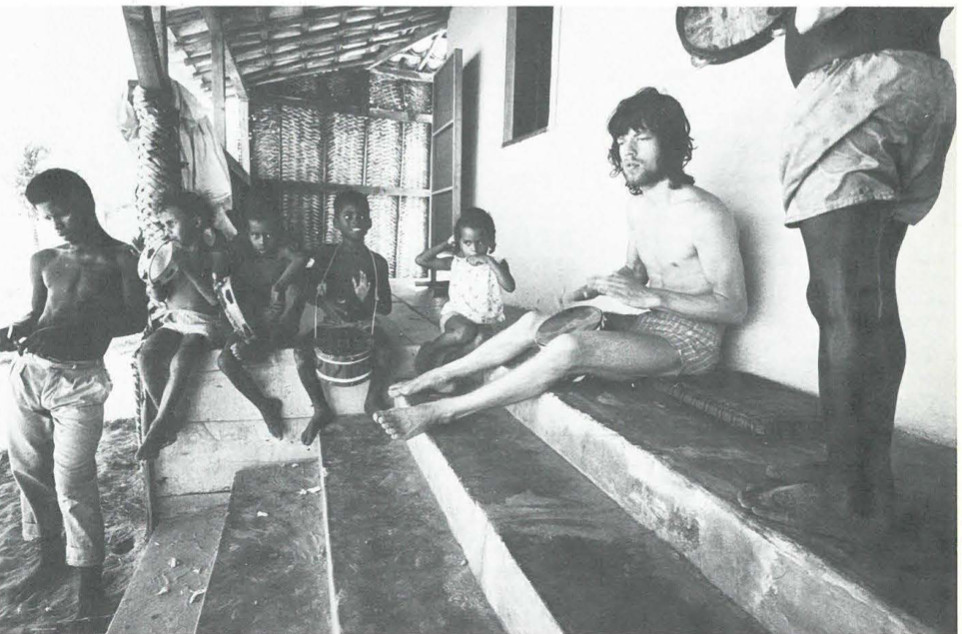 Mick Jagger stoned playing a drum with kids in Brazil