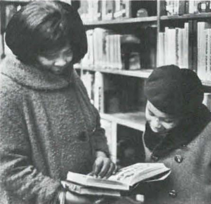 Mother and Daughter Perusing a Book