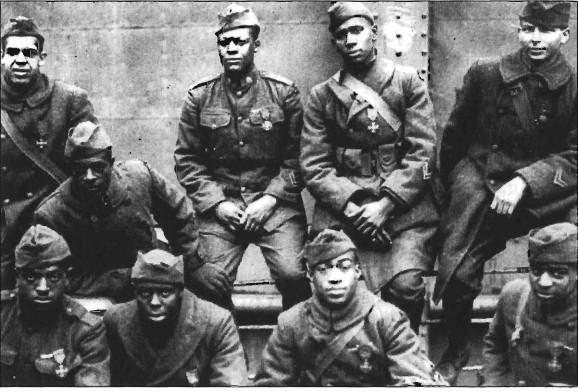 """Enlisted men of the 369th R.I.U.S, (15th New York) on a ship returning from France, all decorated with the """"French Croix de Guerre."""""""