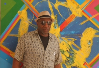 "In the background, ""Ode To A Cannonball Solo"" for J. Overstreet & William T' - Ademola Olugebefola's painted tribute to Joe Overstreet of Kenkeleba Gallery and artist William T Williams. Photograph taken @ Columbia University Wallach Gallery Inaugural Harlem Triennial, 2017. Photo by Playthell Benjamin"