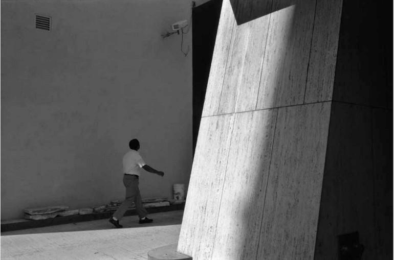 Dawoud Bey, A Man Walking Into a Parking Garage, 1981, silver gelatin print, 20 x 24 in.© Dawoud Bey. Courtesy Stephen Daiter Gallery.