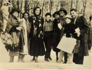 This group shot taken in Paris by photographer Richard Allen. (l-r) Coreen Simpson, Rene Minus White, Audrey Smaltz, A Fashion Photographer, IoniaDunn Lee, Sandra Martin, Lanette Little, and Al Grundy.